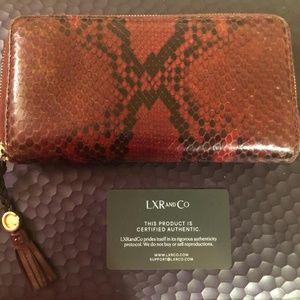 Gucci Python Fringe Tassel Zip Wallet